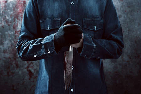 Killer with a bloody knife