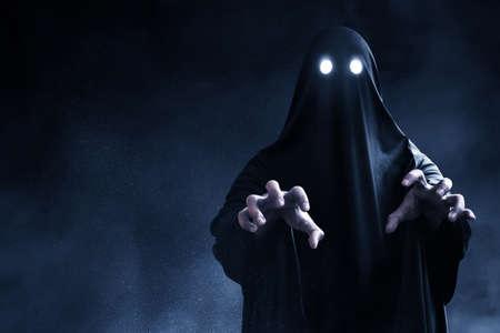 Scary ghost on dark background Zdjęcie Seryjne