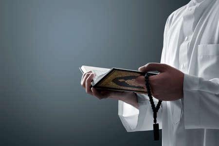 Religious muslim man reading holy quran