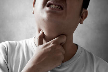 Young man with sore throat