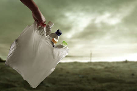 Plastic bottle in garbage bag