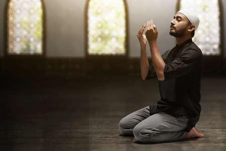 Hands of muslim man praying Archivio Fotografico