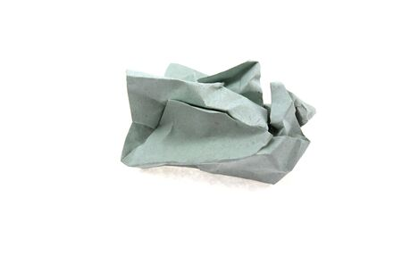 The grey crumpled sheet isolated on a white background photo