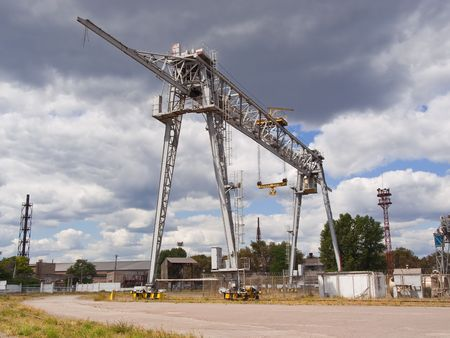 The bridge crane against the blue sky photo