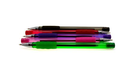 Five multi-coloured pens isolated on a white background photo