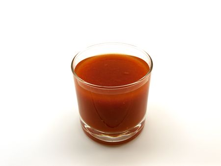 alcohol series: Low glass of tomato juice isolated on a white background Stock Photo