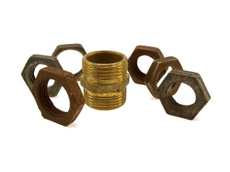 phon: Some old rusty steel screw nuts isolated on a white phon Stock Photo
