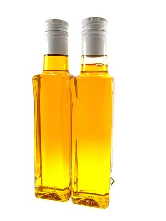 unopen: Two bottles with yellow linen oil isolated on a white background Stock Photo