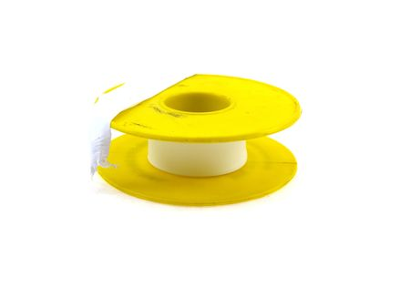 Insulating sanitary tape in the yellow coil isolated on a white background photo