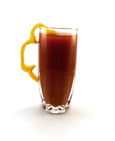 Glass of tomato juice with a pepper segment isolated on a white background photo