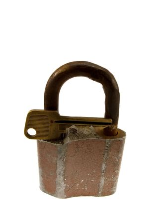 oxidize: The old hinged lock with a key isolated on a white background