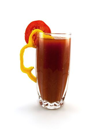 Glass of tomato juice with a pepper and tomato segment isolated on a white background Stock Photo - 5737370