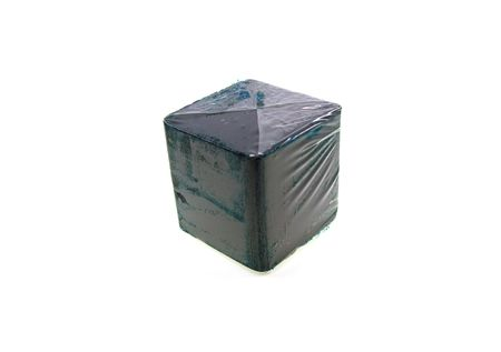 Dark blue cube for a toilet bowl isolated on a white background photo