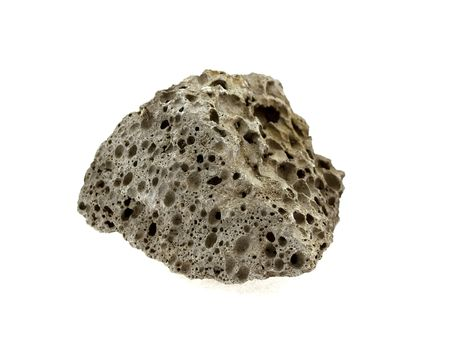 porous: Piece of grey slag isolated on a white background