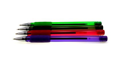 Four multi-coloured ball pens isolated on a white background photo