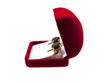 Box with gold earrings isolated on a white background Stock Photo - 5788701