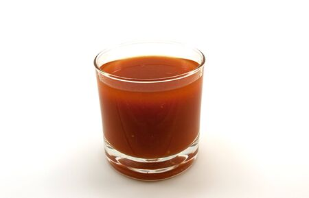 Low glass of tomato juice isolated on a white background Stock Photo - 5801772