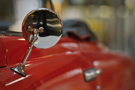 rearview: Red old-fashioned car rear-view mirror