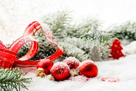 Christmas decorations, balls and ribbon in red Standard-Bild