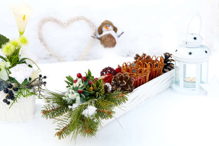 Table decorations on snow garden table photo