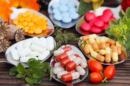 Pills, tablets, capsules and medicinal herbs Stock Photo - 21830611