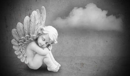 guardian angel: angel on gray background Stock Photo
