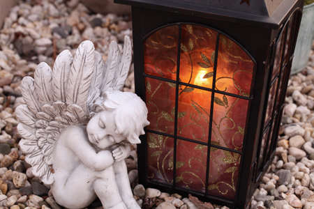 grave angels and lantern Stock Photo
