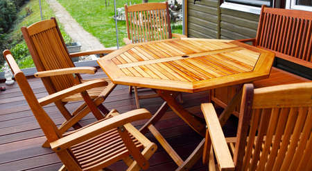garden furniture wood patio furniture freshly oiled stock photo