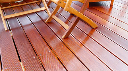 Wooden furniture on patio oiled bangkirai