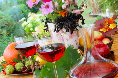 Red wine in late summer on the terrace photo