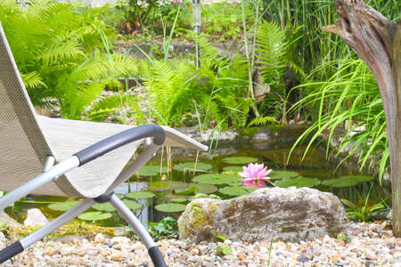 Recliner chairs for the garden pond photo
