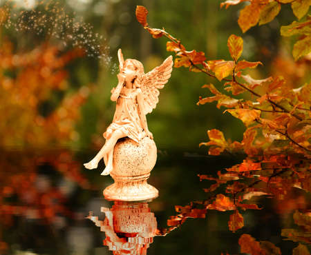 Angels in the autumn leaves photo