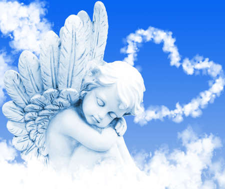 Angel dreams before heart from clouds photo