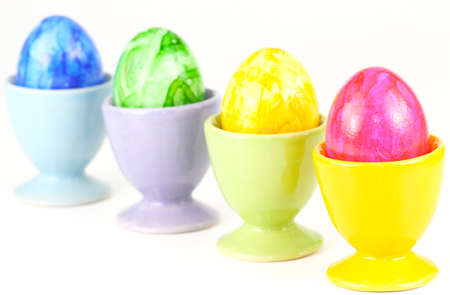 Lined, colorful eggs photo