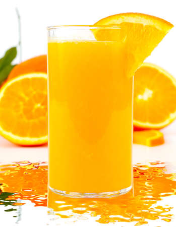 Freshly squeezed orange juice and water reflections Фото со стока