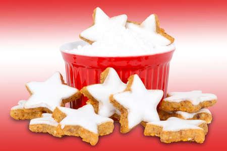 powdered sugar: Cinnamon stars and powdered sugar on red-white background