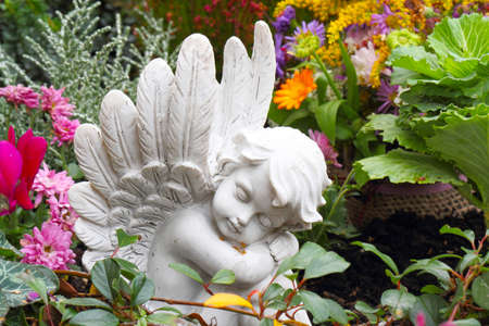 transience: Grave angel in autumn Stock Photo
