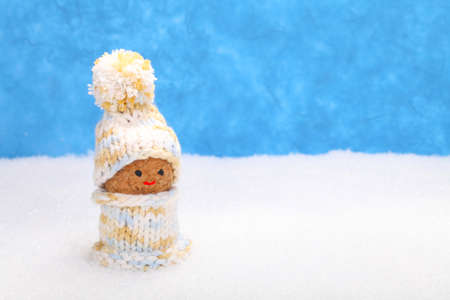 imp: Imp in the snow with winter clothes Stock Photo