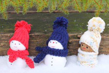 Snowmen with fir branches photo