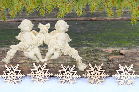 Christmas card with angels, stars and fir photo