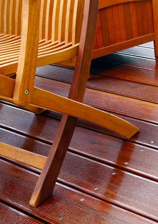 oiled: Wooden furniture on oiled bangkirai terrace Stock Photo