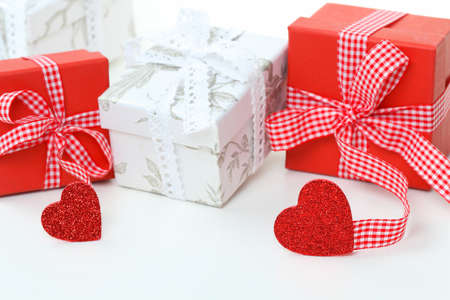 Red and white gifts with ribbon and hearts photo