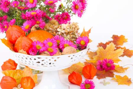 autumn motif: Autumnal table decoration on white