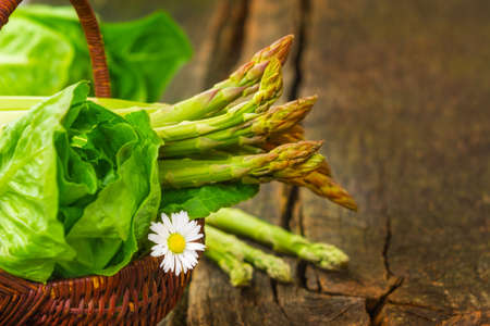 Basket with asparagus and salad