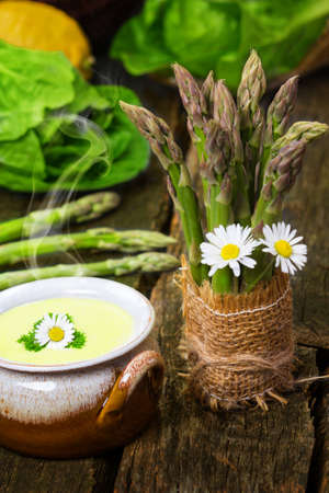 Asparagus soup and green asparagus photo