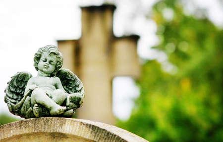 Angel on grave stone  Stock Photo