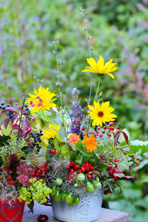 autumn flower arrangement on garden table photo