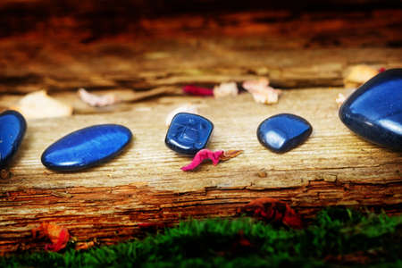 esotericism: Healing stones on old wood Stock Photo