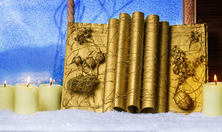 tinkered: Christmas book, candles Stock Photo