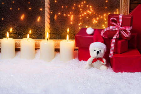 windowpanes: Teddy with candles and gifts Stock Photo